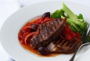 Beef steaks with tomato sauce